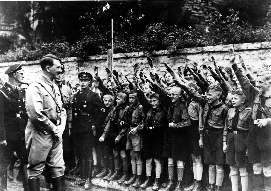Hitler youth saluting Hitler