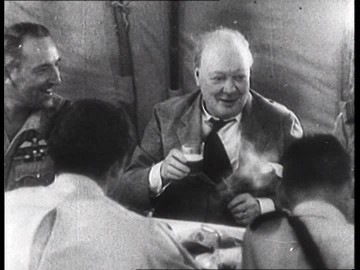476449411-british-prime-minister-winston-churchill-cigar-troop-visit